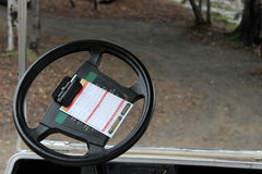 Scorecard in the glofcart. Golfing scorecard clipped to the steering wheel of a golfcart Royalty Free Stock Photos