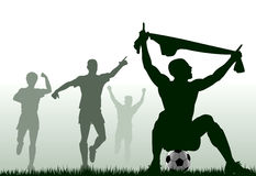 Scored. Editable  silhouette of a soccer player celebrating a goal plus team-mates Stock Images
