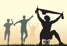 Scored. Editable  silhouette of a soccer player celebrating a goal plus team-mates Stock Photos