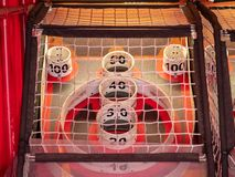 Scoring area of skee ball game behind a net with values of 10 to 100 stock photos
