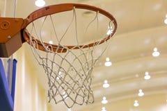 Scoring basket in basketball court Royalty Free Stock Photo