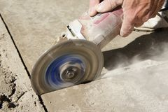 Scoring Concrete with an Angle Grinder Stock Image