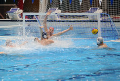 Scoring a goal during water polo match Royalty Free Stock Photo