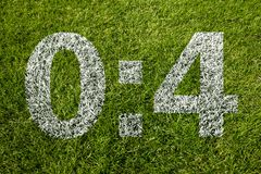 0:4 scoring. On soccer meadow Royalty Free Stock Images