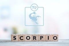 Scorpio gwiazdy znak na stole Fotografia Royalty Free