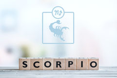 Scorpio star sign on a table. Scorpio star sign on a wooden table royalty free stock photography