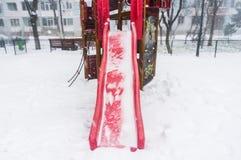 Scorrevole di congelamento del campo da giuoco Fotografie Stock