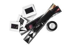 Scorrevole, lente di ingrandimento e strisce di pellicola fotografie stock
