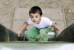 Scorrevole rampicante del ragazzo Fotografia Stock Libera da Diritti