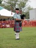 Scot jouant des pipes Photos libres de droits