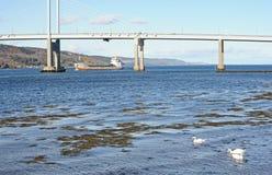 Scot Ranger coming  into Port at Inverness. MV Scot Ranger sailing under Kessock Bridge coming into Port at Inverness Royalty Free Stock Images
