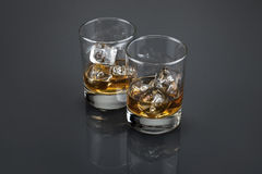 Scotch or bourbon filled glass tumblers stock photo