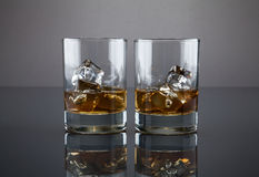 Scotch or bourbon filled glass tumblers Stock Photos