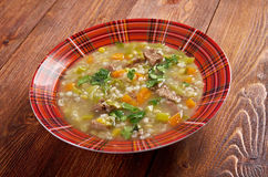 Scotch Broth Soup. Farmhouse kitchen.old fashioned thrifty soup made from meat on the bon Stock Photography