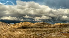 Scotch Creek Wilderness In The Summer. Scotch Creek wilderness area in the summer with dry hills and dark ominous storm clouds in Okanogan county, Washington royalty free stock photo