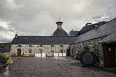 Scotch distillery. The old stone building scotch distillery, rugged territory, fine whiskey, Scotland, UK Royalty Free Stock Photos