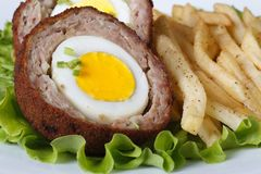 By scotch egg and fried potatoes macro Royalty Free Stock Images