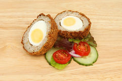 Scotch egg halves with salad Stock Photography