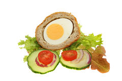 Scotch egg and salad garnish. Half a Scotch egg and salad garnish isolated against white Stock Images