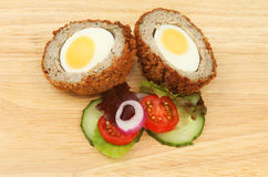 Scotch egg and salad Stock Images
