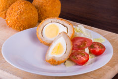 Scotch egg. Scoth eggs iwth salad garnish royalty free stock photos