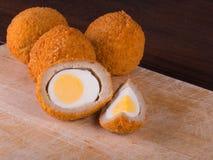 Scotch egg. Tasty scotch eggs on cutting board royalty free stock image