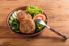 Scotch egg with vegetables. On a wooden background Royalty Free Stock Photography