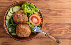 Scotch egg with vegetables. On a wooden background Royalty Free Stock Photos