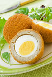 Scotch Eggs. On a plate with a green salad stock photo
