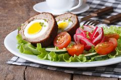 Scotch eggs with salad of fresh vegetables Royalty Free Stock Photography