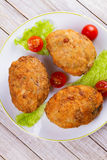 Scotch Eggs Served with Tomato Cherry and Salad on White Plate. View From Above, Top Studio Shot. Royalty Free Stock Image