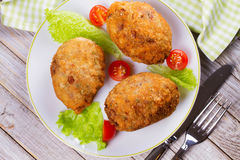 Scotch Eggs Served with Tomato Cherry and Salad on White Plate. View From Above, Top Studio Shot. Royalty Free Stock Photos