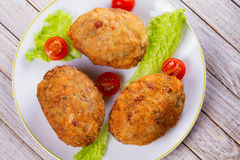Scotch Eggs Served with Tomato Cherry and Salad on White Plate. View From Above, Top Studio Shot. Stock Photography