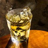 Scotch Glass. Ice cubes flying into a tumbler of scotch Royalty Free Stock Image