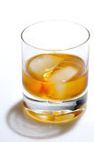 Scotch and ice in a glass. Scotch and ice in a rock glass Stock Photos