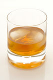 Scotch and ice in a glass. Scotch and ice in a rock glass Royalty Free Stock Image