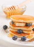 Scotch Pancakes with fruit and honey Royalty Free Stock Photography