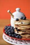 Scotch pancakes with raisins. Blueberries & honey - shallow dof Stock Photo