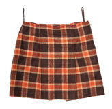 Scotch Plaid Skirt. Mini pleated skirt with scotch plaid texture, isolated on white Royalty Free Stock Photography