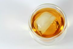 Scotch on The Rocks. A glass of scotch with an ice cube Stock Photo