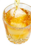Scotch on the rocks being poured Royalty Free Stock Images
