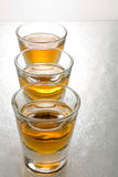 Scotch in shot glasses royalty free stock images