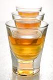 Scotch in shot glasses stock image