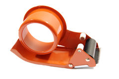 Scotch tape in the holder. Catch Scotch tape for security and comfort on a white background Stock Images