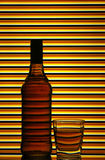 Scotch whiskey bottle and glass Stock Photography