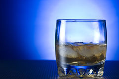 Scotch whiskey in glass with ice Stock Photography