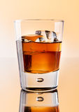 Scotch whiskey with ice cubes Royalty Free Stock Photography
