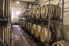 Whiskey and brandy distillery. Scotch Whisky Barrel rows. Whiskey and brandy distillery. Oak barrel used to age whiskey royalty free stock photos