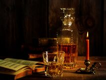 Free Scotch Whisky Ice With Burning Candle Old Book Stock Photo - 184355930