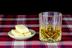 Scotch Whisky and Shortbread on a Tartan Table Cloth Royalty Free Stock Photo